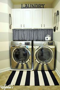 Use a curtain on a tension rod to hide detergent and more! (image: Sophia's Decor)