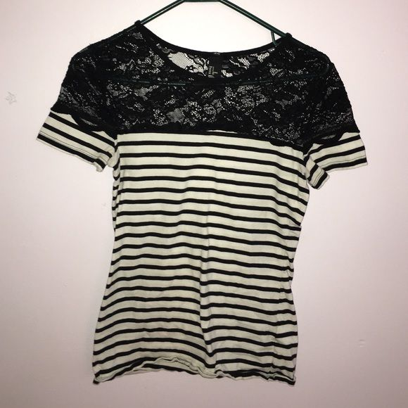 Black and white striped t shirt Black and white striped t shirt with black lace on the top. Make offers  H&M Tops Tees - Short Sleeve