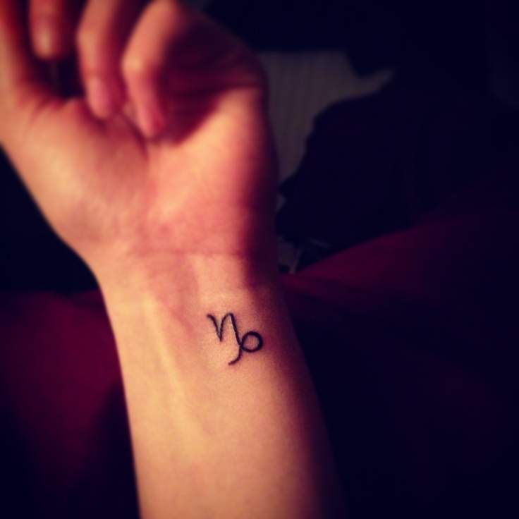 Simple Capricorn tattoo on wrist.. White ink?