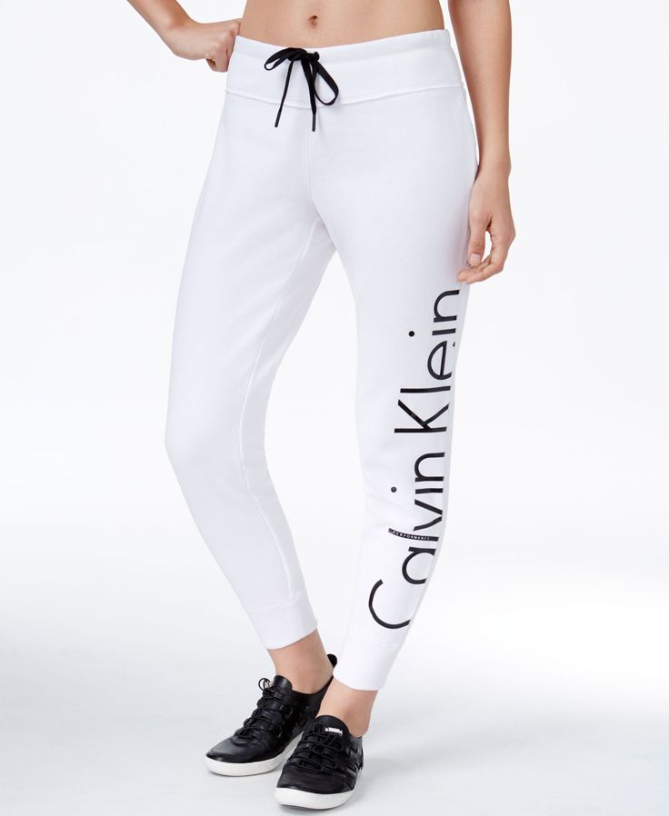No matter your plans for the day, you'll stay comfortable and cozy in these stretch fleece sweatpants from Calvin Klein Performance. | Cotton/polyester | Machine washable | Imported | Mid rise; slim f