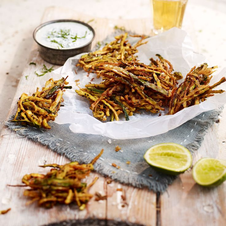 A moreish little courgette recipe – packed with spicy Indian flavour and served with cooling and refreshing yogurt dip.