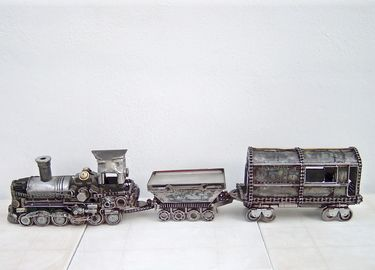 METAL ART TRAIN SCULPTURE handmade by artist Yiannis Dendrinos Welded car parts Anti-rust varnished for indoor use Ships in 7-10 working days Certificate of authenticity available on demand Shipping cost calclulated on demand
