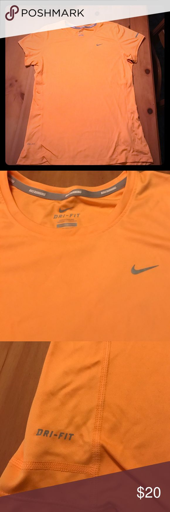 Nike Women's Dri-Fit Shirt Nike women's Dri-fit tshirt. Light orange. Comfortable, stretchy, soft material. 100% recycled polyester. Worn gently twice no signs of wear. Nike Tops Tees - Short Sleeve