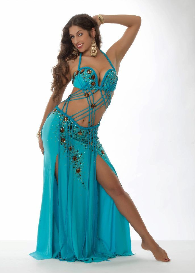 Belly Dance Costume in turquoise.  Interesting stripes connecting the bra and skirt.