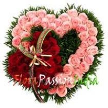 Sweetness & Light: Stunning heart shape arrangement of 75 Pink and Red roses to impress to your loved one.