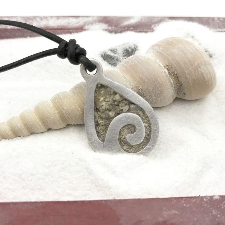 Beach Jewelry – What better way to remember your time spent there than a beautiful sterling silver ocean wave beach sand necklace.