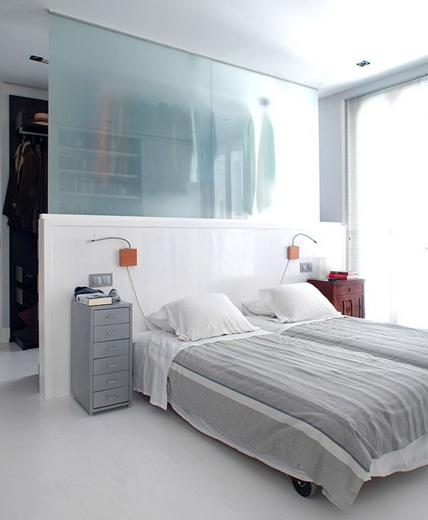 Clever Wardrobe Design Ideas For Out-Of-The-Box Bedrooms | Hide your wardrobe or closet behind a glass divider. For example, this bedroom has a very interesting design. It's a semi-open space and only part of the divider is made of glass. Also, it doesn't go from one side of the room to the other.