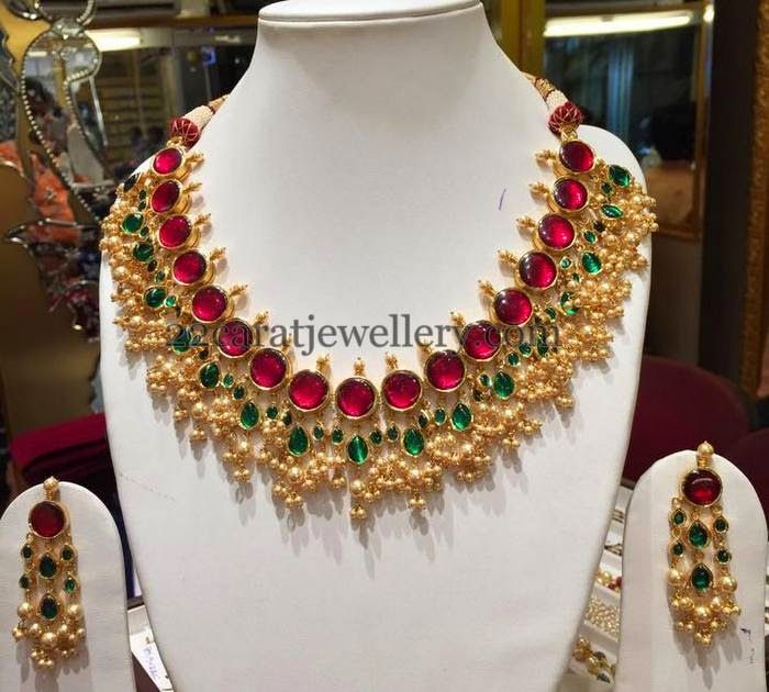 22 carat gold jadatar kundan necklace with gold balls bunches and small pearls hanging throughout. studded with large round pots rubies, ...