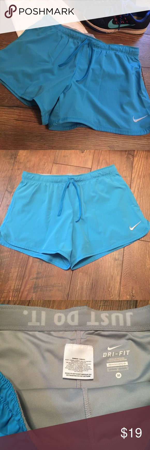 Nike Dry Fit Shorts These are a pair of light blue Nike dri fit shorts. They are a size medium and have a white Nike emblem on the front. Please let me know if you have any questions. Thanks Nike Shorts