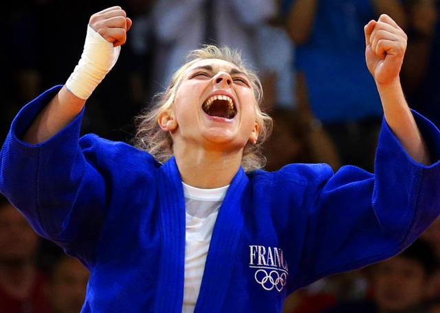 Automne Pavia, of France, reacts after winning her bronze medal against Hedvig Karakas of Hungary, during the women's 57-kg judo competition.