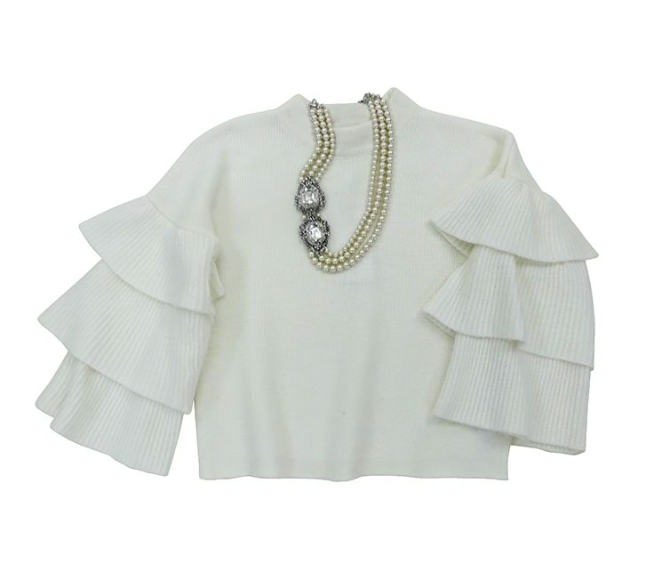 White mohair ruffle sleeve sweater. $119.00 Pearl with rhinestone closure necklace. $89.99  Coqui Boutique 703-413-5441