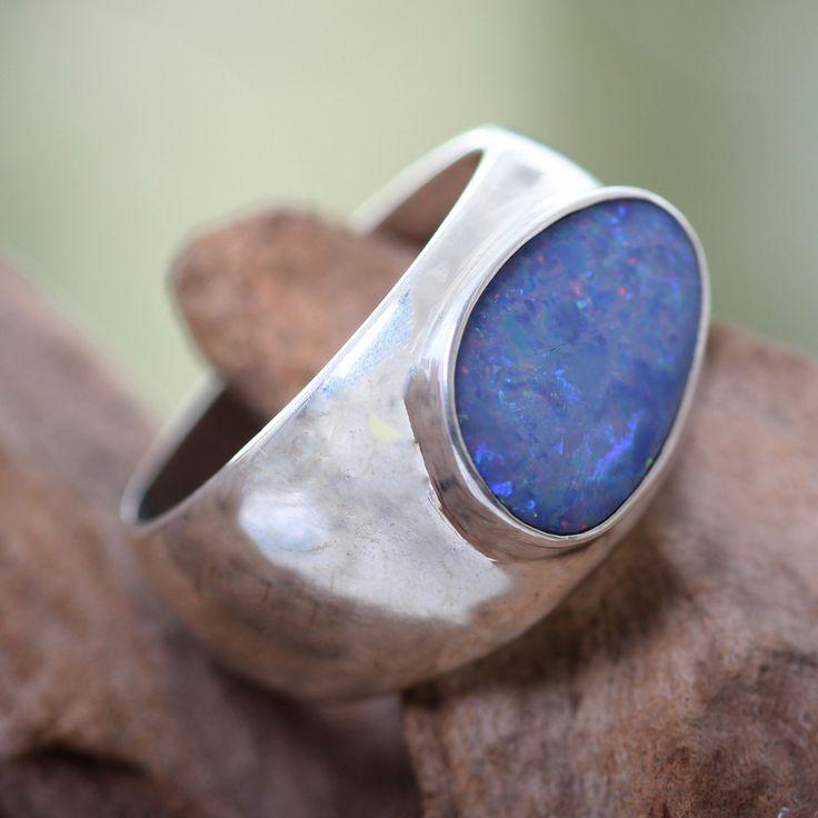 <li>Opal accent ring</li><li>Sterling silver jewelry</li><li><a href='http://www.overstock.com/downloads/pdf/2010_RingSizing.pdf'><span class='links'>Click here for ring sizing guide</span></a></li>