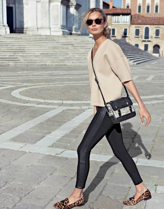 Dress in a beige short sleeve sweater and black leggings for a lazy day look. Brown animal suede loafers will add elegance to an otherwise simple look.   Shop this look on Lookastic: https://lookastic.com/women/looks/beige-short-sleeve-sweater-black-leggings-brown-loafers/16314   — Beige Short Sleeve Sweater  — Black and White Leather Crossbody Bag  — Black Leggings  — Brown Leopard Suede Loafers