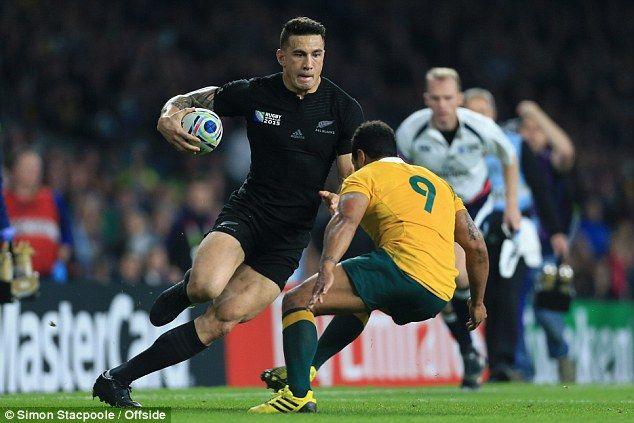 New Zealand live wire Sonny Bill Williams runs at Australia's Queensland Reds scrum-half Will Genia