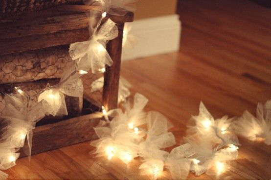 tulle bows tied to Christmas tree lights for a wedding or baby shower in the colors of your event