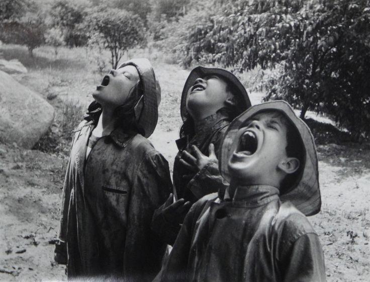 Children Singing in The Rain    photo by Barbara Morgan, 1950