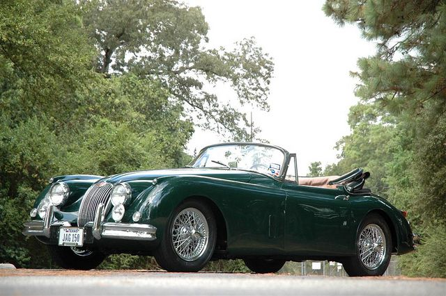 The Jaguar XK150 is a sports car produced by Jaguar between 1957 & 1961. It replaced the XK140.  Initially it was available in Fixed Head Coupé (FHC) and Drophead Coupé (DHC) versions. The Roadster (XK150 OTS - Open Two-Seat) was launched in 1958. Minimal rear seats were fitted in the coupés.