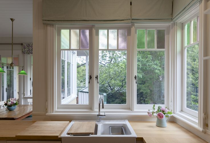 Casement windows with colonial bars and coloured glazing by Against the Grain Windows & Doors