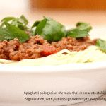 Spaghetti bolognaise for everyone. Top with fresh basil, a rich pasta sauce and grated parmesan cheese. http://www.planeatplay.com