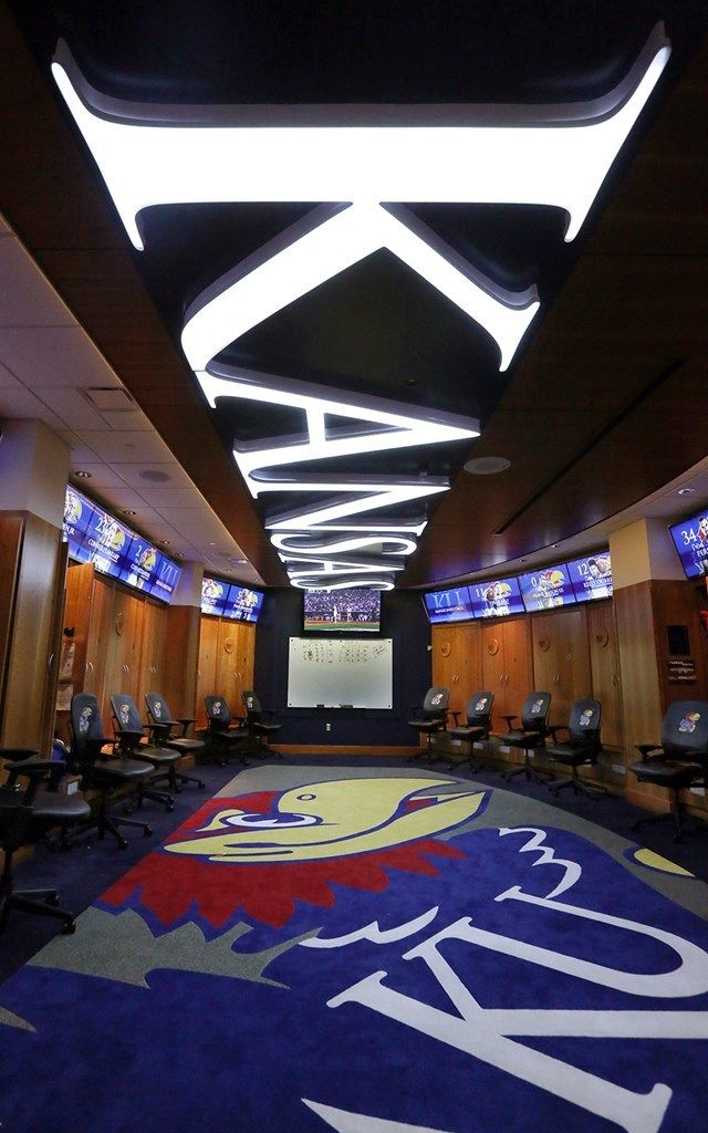 A Dramatic Illuminated Ceiling Highlights The Locker Room
