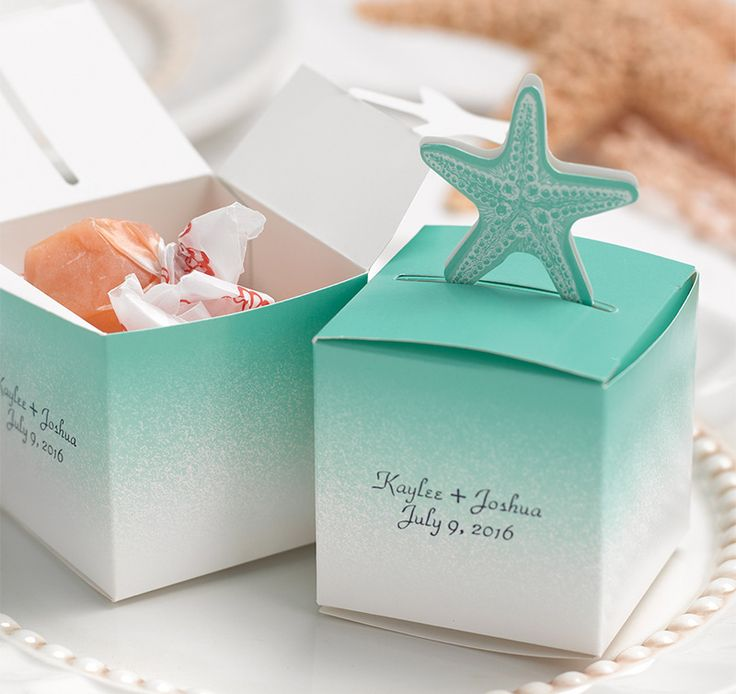 "Starfish Pop-Up Favor Boxes are a must-have accessory for any beach theme wedding or event.  Favor box is available in aqua and white and may be personalized with two custom lines in your choice of font style and foil color.  Add your favorite treat or homemade goodie and give it as a ""thank you"" gift to your guests for being part of your special day."