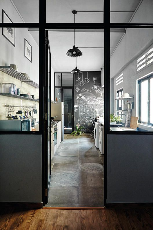 A home with clean, streamlined design, with a masculine colour scheme of grey, black, white and wood tones.