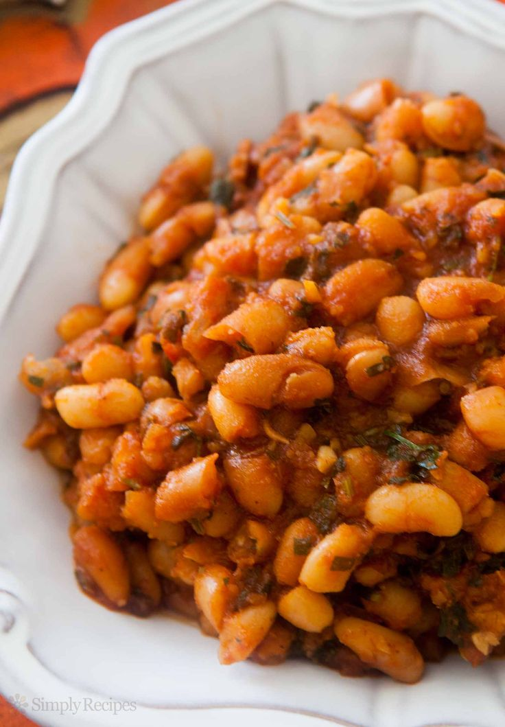Baked Beans in Tomato Sauce ~ White beans baked in tomato sauce with bacon, onions, garlic, honey, stock, and chili pepper flakes. ~ SimplyRecipes.com
