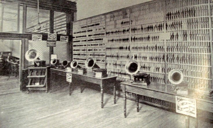 The record department of Bloomingdale's Bros. store in New York. Columbia Records were featured in this fine music department in 1904. A handful of basic gramophone models were displayed on tables with records lining the walls.