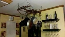 Pot rack made from an antique sled:)