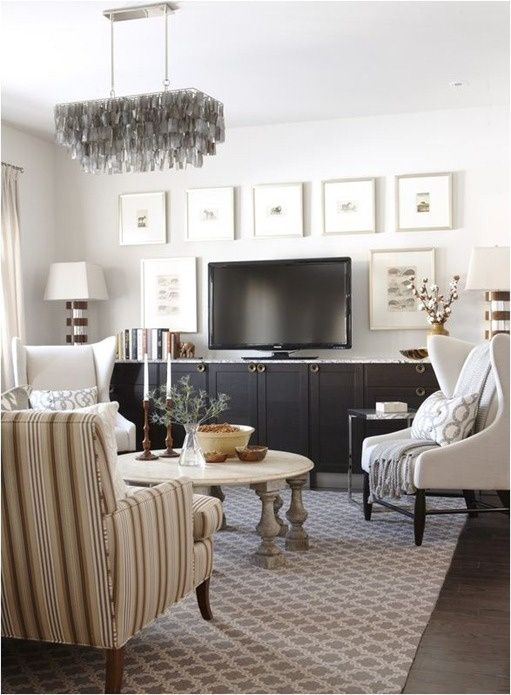 Great tv console idea by sarah richardson-- she used kitchen cabinets (IKEA, I think) and gained horizontal storage