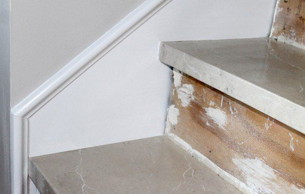 Top of stairs painted to look like marble!