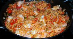 Dutch Oven Jambalaya - did cooked chicken, small shrimp, and extra veggies, especially onion, and one can was tomatoes with green chili for some extra heat.  Family loved it, and it worked great for our first true campfire dutch oven meal!