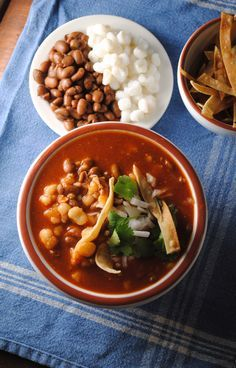 Pozole de Frijol -- 1 or 2 (or more) dried chilis de Arbol, ancho, or guajillo chilis, 1 onion,  4 cloves garlic,  6 cups mild vegetable broth, 1/2 15 oz. can diced tomatoes, 1 tablespoon dried oregano, 1 15 oz. can pinto beans, 2 15 oz. cans hominy,  juice of 2 limes