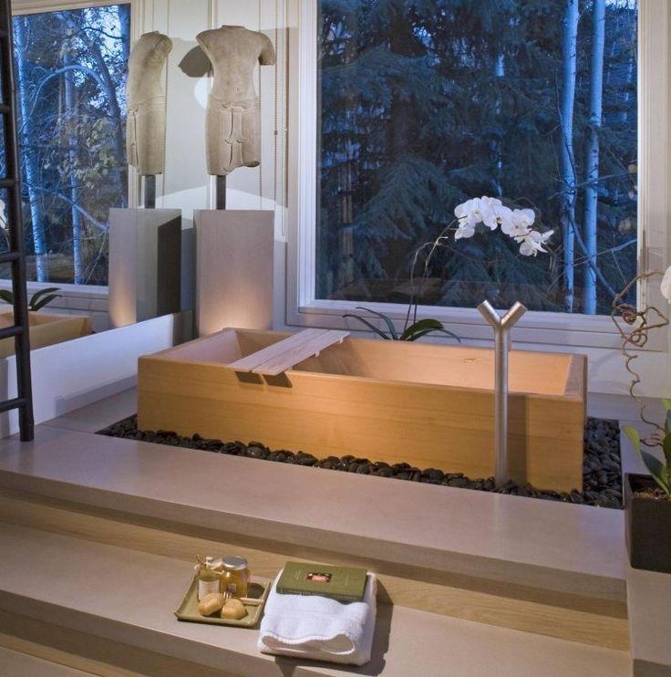 rechteckige holz badewanne vom schwarzen kies umgeben - Badewanne Holzoptik