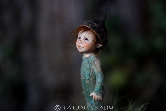 The cute boy you see here is from the folk of pixies. His name is Pinu and he measures 3,5 inch (9 cm) without including the tail of hat. He is fully sculptured by polymerclay. He is not poseable. Hair is from lamb. Cloth and hat can not be taken of. There is a base indluded (see on the pictures). The artdoll will come with certification of origin. Shippment will be insured and comes with tracking number. No toy for children!!!!!!!!!!!!!!!! Hope you enjoy