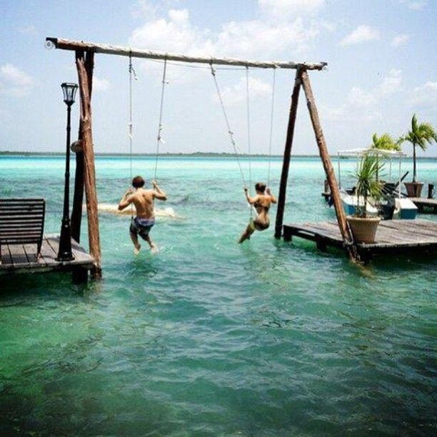 Swing set over the water