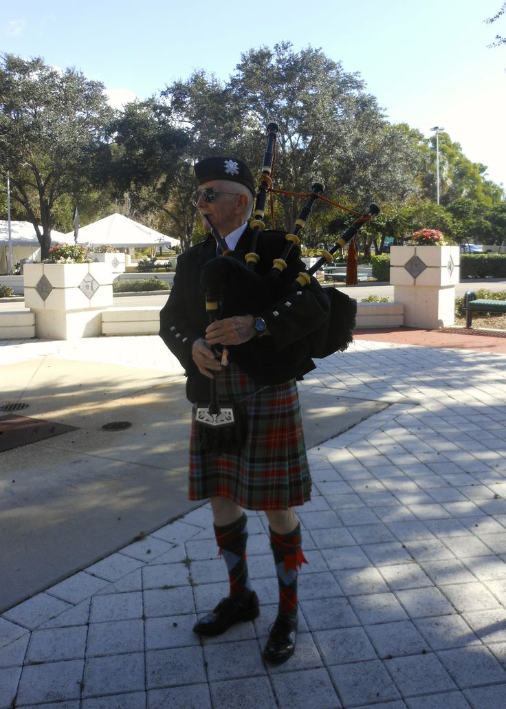 Charley Murray, log time Caledonia Club piper, provided appropriate music to open and close the ceremony conducted Dec. 6, 2013 by Sarasota Mayor Shannon Snyder and members of the Caledonia Club of West Florida & Sister Cities Assn of Sarasota at the point of landing in 1885 of the Scot founders of the City of Sarasota