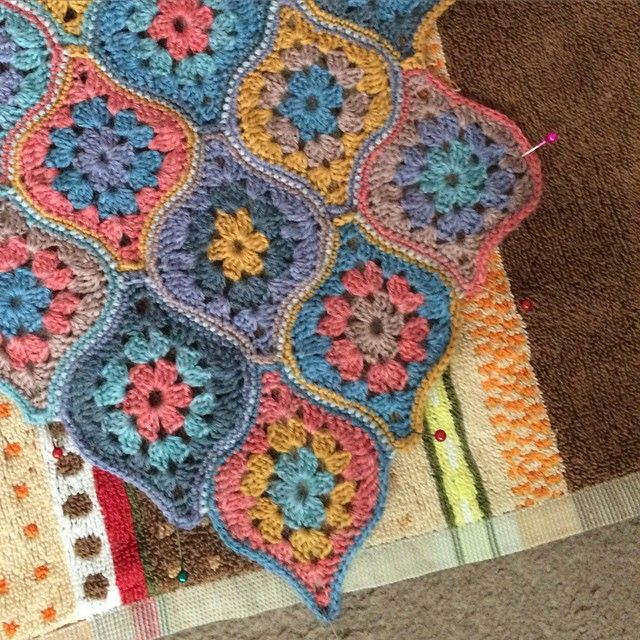 Scarf version of Mystical Lanterns fresh back from my fabulous crocheter blocked out on a towel. Sock weight yarn