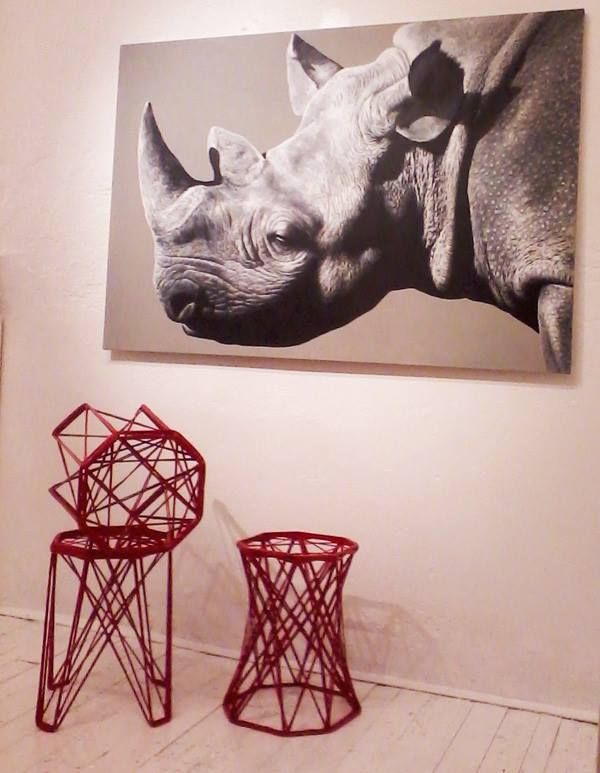 Three Nido stolls designed by Eva Marguerre - Studio Besau + Rhinoceros by Angelo Zanella, oil on canvas.