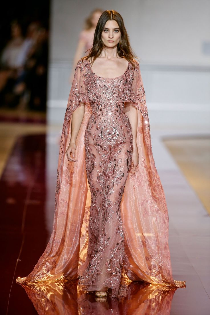 LOOK 26 Ball gown with cap sleeves in rosewood, with a sheer bodice and a skirt…