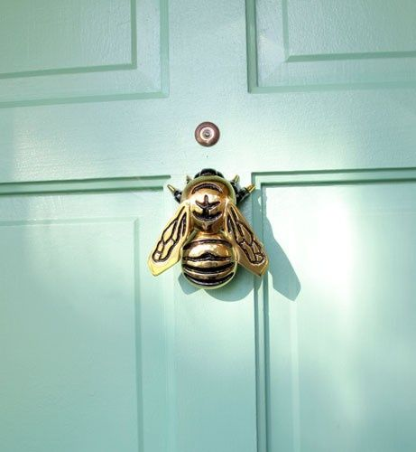 This wonderful bee door knocker can be found at Home Depot! Love the mint door and bee :)