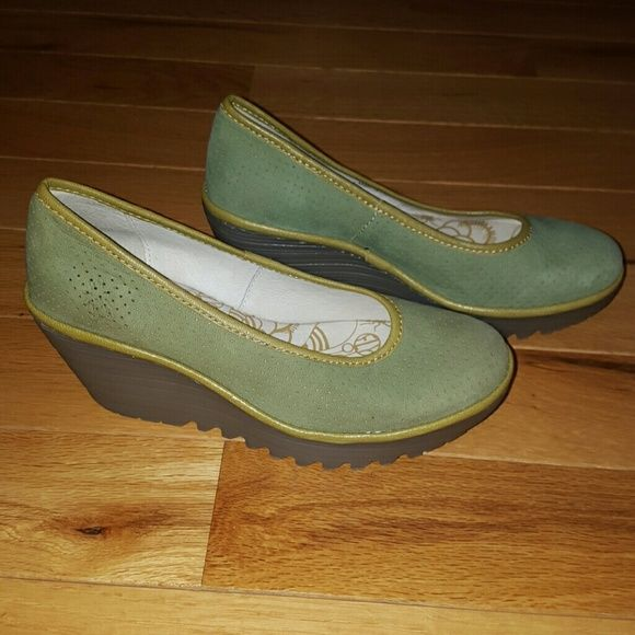 NWOT Fly London Green Perforated Slip Ons NWOT Fly London Green Perforated Slip Ons. Super comfortable and great quality. Amazing sage green suede with rubber 2 1/2 inch heel. Fly London Shoes Wedges