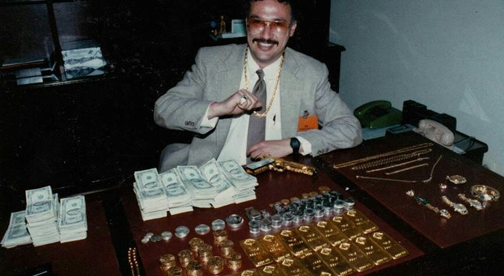 """Javier at the CNP HQ in Bogota following the seizure of money, gold, silver, jewelry, and a gold-plated .45 caliber pistol belonging to Pablo Escobar.  This was considered a small seizure from Escobar because of his vast wealth.  Forbes magazine ranked him as the 7th richest man in he world, with an estimated wealth of between $8 and $30 billion."" Steve Murphy, DEA agent"