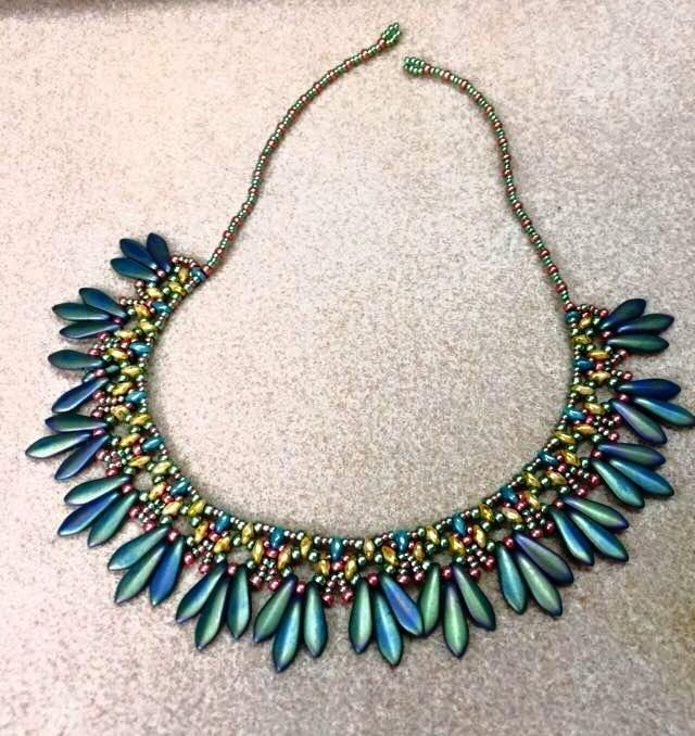 Made using Virginia Jensen's 'SuperDuo and Two-Hole Dagger Necklace' pattern from her book, 'Stitching with Two-Hole Shaped Beads.' A fabulous book!