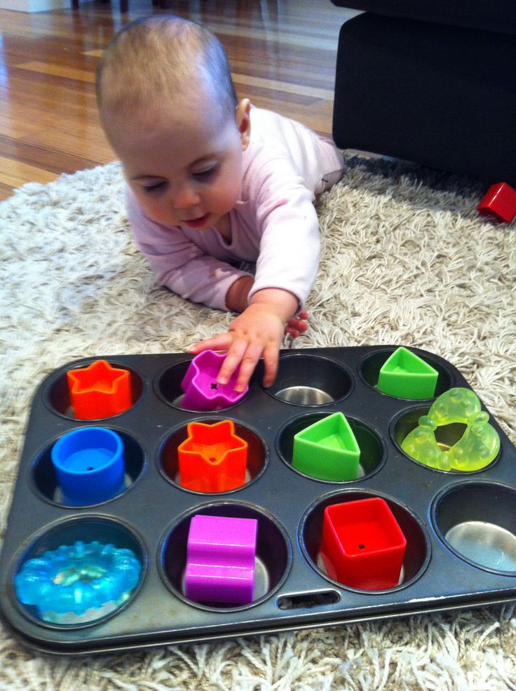 Playing with items on a tray. Great start to building fine motor skills.