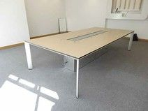 'Bene' veneered meeting table with elegant silver legs and lift-up cable access panel.