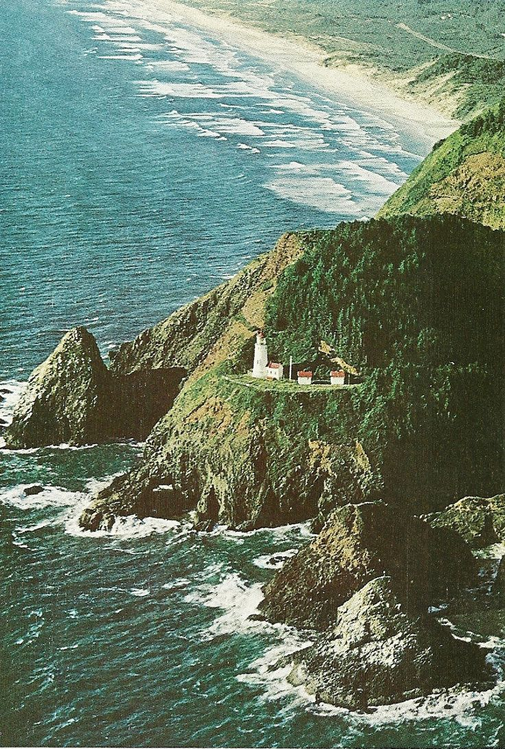 Heceta Head Lighthouse flashes from the rocky
