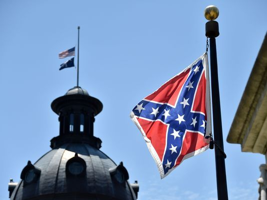 June 20 Tragedy rekindles debate over South Carolina's Confederate flag. For some South Carolina residents, the Confederate flag hanging outside the Statehouse represents their heritage. For others, it is a sobering reminder of the state's dark history — marred by white supremacy and slavery.
