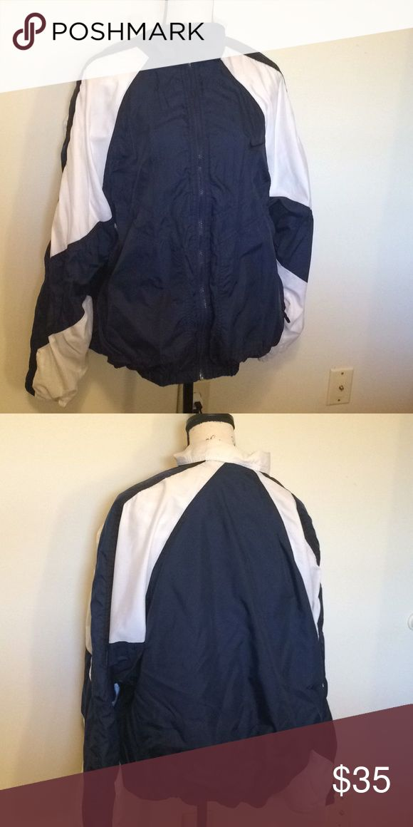 Vintage Nike Coat Men's XL Vintage Nike's Coat. Navy blue and white. I'm good condition - rubber part of the zip tab fell off but zipper still has good use.  Size men's XL. Nike Jackets & Coats