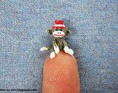 Miniature Sock Monkey With Santa Hat - Tiny Mini Crocheted Grey Monkeys - One Inch Scale. $55.00, via Etsy.